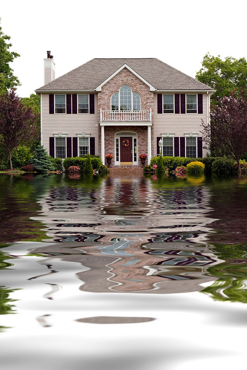 House with flood damage concept in need of water damage restoration