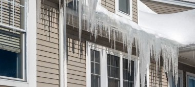 Heavy and dangerous ice dams on sloped Utah roof.
